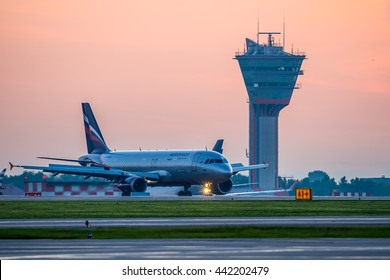 Moscow, Sheremetyevo airport, Russia - June 04, 2016: Airbus A320 Aeroflot VQ-BCM taxiing to terminal after landing at Sheremetyevo international airport at sunrise