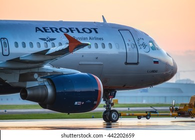 Moscow, Sheremetyevo airport, Russia - June 04, 2016: Airbus A320 Aeroflot taxiing to terminal at Sheremetyevo international airport at sunrise
