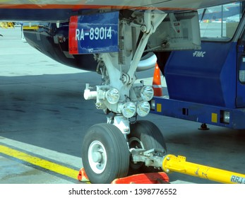Moscow, Sheremetyevo International Airport / Russia 07.30.2014: Front landing gear Aircraft Sukhoi Superjet 100 (SU95) Aeroflot airlines. Board number RA-89014.