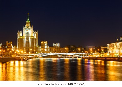 Moscow, Stalin skyscraper on the embankment of the Moscow  River and Yauza river and road traffic in the evening