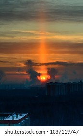 Moscow State University building centered in the sun pillar in the early winter morning, Moscow, Russia.