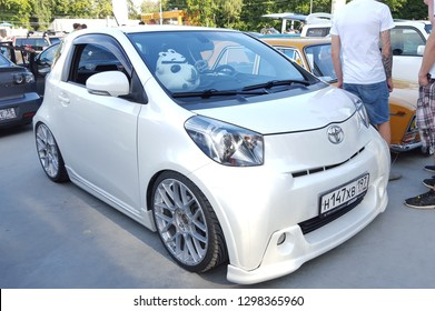 Moscow. Summer 2018. White Toyota IQ on the street. Tuned with air suspension, wide body kit, big exclusive wheels. Lowrider, stance tuning.