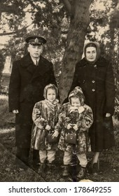 "MOSCOW, USSR - CIRCA 1950s : An antique photo shows Navy officer, his mother and two daughters. ""Soviet people"" series."