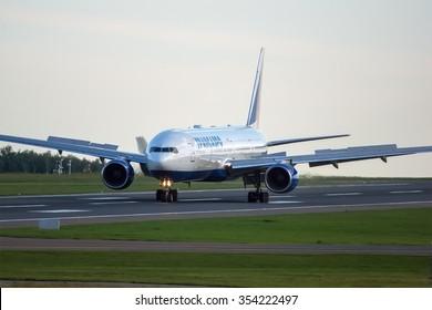 Moscow - Vnukovo, Russia - July 04, 2014: Boeing 777 Transaero EI-UNV landing at sunset at Vnukovo International airport