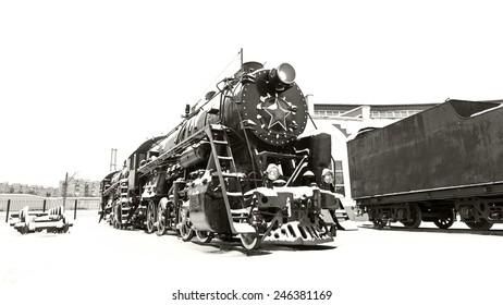 Moscow, winter, repair depot of old Soviet steam locomotive.