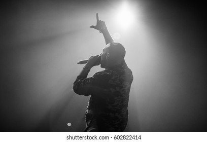 MOSCOW-1 OCTOBER,2015:Concert of famous hip hop singer L'One in nightclub.Popular rapper live musical show in the club.Rap music entertainment event in music hall.Singer with microphone put hand up