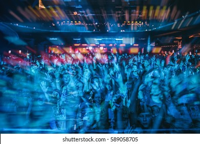 MOSCOW-1 OCTOBER,2015:Group of people party in nightclub.Club audience rave to edm dj music set.Adult night life entertainment show.Crowded dancefloor have fun on concert.Double exposure