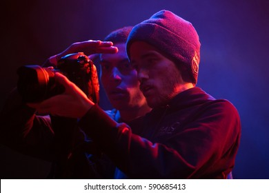 MOSCOW-12 FEBRUARY,2017: Videographer guy filming concert of Waka Flocka in night club.Video camera man shoots footage on stage in nightclub.Operator film concert,music festival with dslr cam