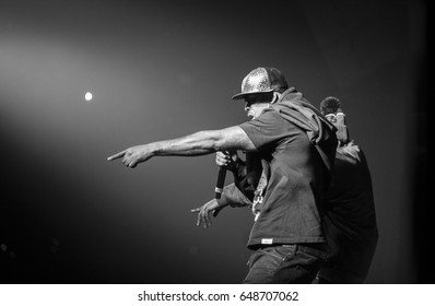 MOSCOW-13 NOVEMBER,2015: Popular American hip hop band Wu-Tang Clan performing live in night club.Famous rap singer on stage.Black & white shot of celebrity rapper Method Man