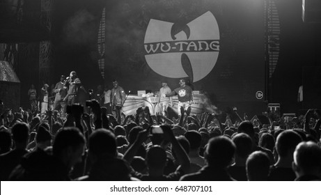 MOSCOW-13 NOVEMBER,2015:Famous American hip hop band Wu-Tang Clan performing live in night club.Cool rap singer on stage.Black & white shot of hip hop celebrity band Wu Tang in the club