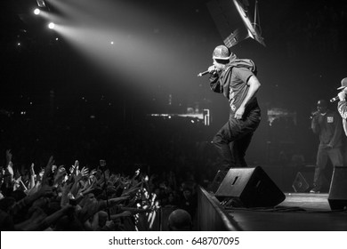 MOSCOW-13 NOVEMBER,2015:Popular American hip hop band Wu-Tang Clan performing live in night club.Famous rap singer on stage.Black & white shot of legendary rapper Method Man