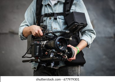MOSCOW-14 JULY,2017:Professional video operator films event with camera mounted on stabilized vest.Red One cam shoots high quality footage in 5k resolution