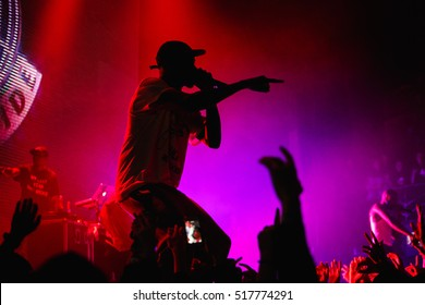 MOSCOW-15 NOVEMBER,2016:Famous rap band Asap Mob performing live hip hop music show on nightclub stage.Silhouette of rapper singer with microphone on scene.Concert in crowded music hall