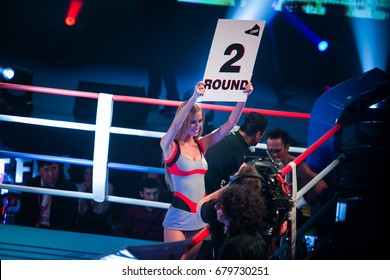 MOSCOW-18 MARCH,2016: Big professional boxing event Fight For The Future at indoor sport arena.Young go go girl with round sign