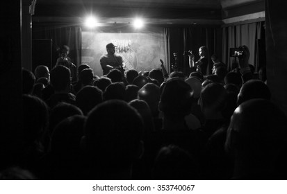 MOSCOW-19 DECEMBER,2015:Rap concert in night club.Famous hip hop beatmaker Apollo Brown play live music set in dark nightclub.Concert audience party on dj concert in bar.Dj concert,young people party