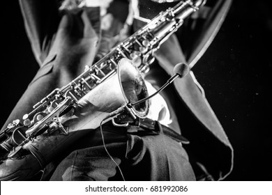MOSCOW-19 NOVEMBER,2016:Sax player with saxophone.Jazz band Parov Stelar live music show on stage in nightclub.Saxophonist playing on stage at concert