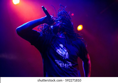 MOSCOW-2 FEBRUARY,2017:Famous hip hop singer Waka Flocka performing live music show on stage.Bright concert lighting on popular rapper.Cool braided African American singer with microphone on scene