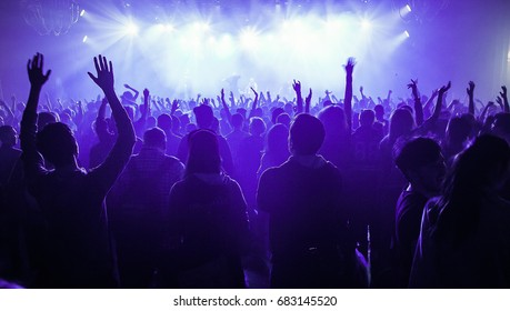 MOSCOW-2 MAY,2015:Concert crowd.Music fans enjoy show in nightclub.People put hands up to favorite musician.Group of excited music fan wave hands to favorite dj.Festival background
