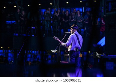 MOSCOW-21 FEBRUARY,2015:Rock concert of Billys Band in music hall.Famous blues and rock&roll band performing live set on stage.Frontman Billy plays guitar on scene in bright lights