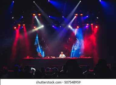 MOSCOW-21MAY,2016:Party in nightclub.Headliner famous DJ Kentaro.Disc jockey plays music on turn table vinyl record player & scratch records.Musician mix musical tracks on turntables in the club