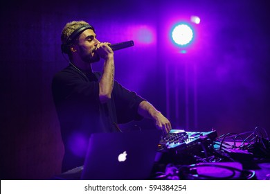 MOSCOW-22 FEBRUARY,2017:Cool party dj Nerak performing on stage.Popular edm & trap music set on scene in nightclub.Music festival disc jockey talking in microphone on stage.Disco club night event