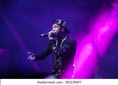MOSCOW-22 NOVEMBER,2014: Famous American rapper Tyga performing on stage in nightclub.Hip hop singer singing on scene.Rap star concert in the club