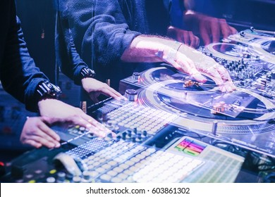 MOSCOW-22 NOVEMBER,2015:Popular club djs Tropkillaz play electronic music set on stage in night club.Famous disc jockey band mix tracks on scene in double exposure & bright blue lights.DJ scratches