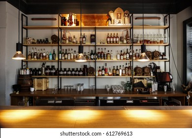 MOSCOW-26 MARCH,2017:Popular bar interior with bottles on shelves.Adult night life entertainment background.Bar stand in cheap restaurant