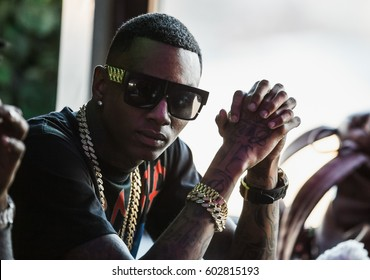 MOSCOW-27 MARCH,2015: Portrait of famous hip hop singer Soulja Boy on press interview conference.Cool rap star celebrity dressed in gold chains and fashion sunglasses