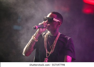MOSCOW-27,MARCH,2015:Popular American rap singer Soulja Boy music show on stage in nightclub.Cool tattooed hip hopper with gold chains & bling sings on scene in professional radio microphone