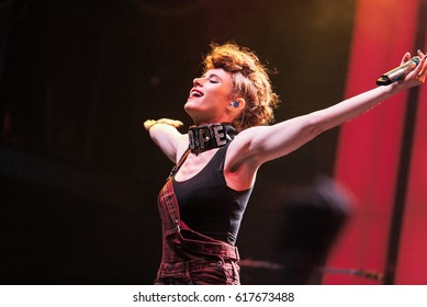 MOSCOW-29 JANUARY,2015: Concert of famous Canadian pop singer Kiesza in night club.Stylish young white singer girl performing music show on stage in nightclub