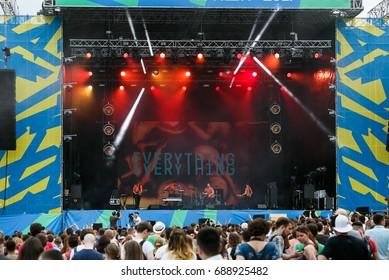 MOSCOW-29 JULY,2017:Summer music festival.Outdoor rock concert gig.Rock band Everything Everything performing live set on stage at open air event Picnic.Group of young people listening to music