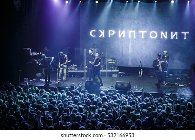 MOSCOW-3 DECEMBER,2016: Popular Russian rap singer Scriptonite sings on scene in the club.Big hip hop music concert in nightclub.Bright stage lighting,crowded dancefloor.Entertainment event
