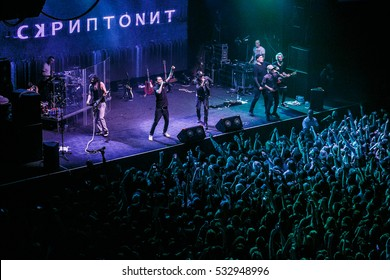 MOSCOW-3 DECEMBER,2016: Popular Russian rap singer Scriptonite sing on scene in the club.Bright stage lighting,crowded dancefloor.Entertainment event.Big hip hop music concert in nightclub.