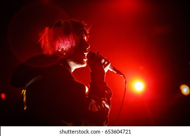 MOSCOW-30 MARCH,2017: Famous American emo singer Lil Peep performing live set on stage in nightclub.Young rapper with face tattoos sing on scene.Gustav Ahr portrait