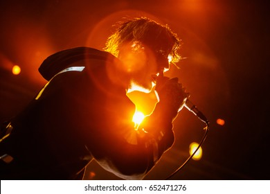 MOSCOW-30 MARCH,2017:Last concert of famous emo rap singer Lil Peep in Moscow.Rapper with mic sings on scene.Gustav Ahr last concert in Russia before he died