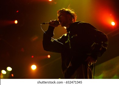 MOSCOW-30 MARCH,2017:Portrait of Lil Peep.Famous American emo-trap singer Lil Peep performing live set on stage in nightclub.Young rapper with face tattoos sing on scene.Rap singer Lil Peep sings