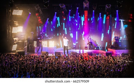 MOSCOW-30 NOVEMBER,2014: Music concert of rap singer LOne.Live entertainment event in nightclub.Rapper with mic on scene in front of big concert audience.Night festival background