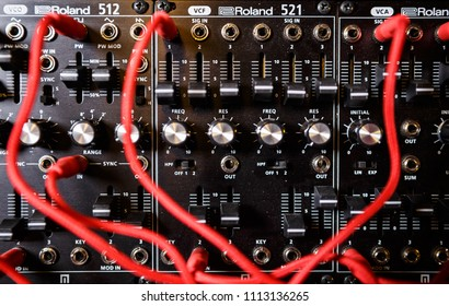 MOSCOW-4 AUGUST,2018:Professional electronic synthesizer board for music composer.Synth panel for composing new musical tracks.Many audio cables connected to analog sound recording device