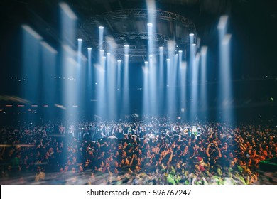 MOSCOW-4 NOVEMBER,2016:Crowded dance floor in nightclub.Group of people have fun on dj concert.People party on music festival.Fans in mosh pit enjoy entertainment show.Big live music event in the club