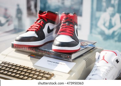 MOSCOW-6 AUGUST, 2016:Rare Nike Air Force 1 basketball sneakers in black, white & red colors.Nike basketball fashion shoes on stand at fashion exposition.Fashionable foot wear for youth & Apple II pc