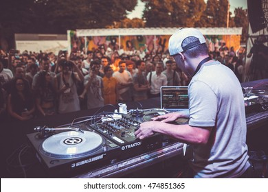 MOSCOW-6 AUGUST,2016: DMC DJs World Russian stage at Faces&Laces Festival.Famous DJ Qbert mix music with scratch scratching vinyl records on turntable at music festival,view from stage