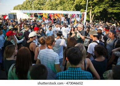 MOSCOW-6 AUGUST,2016:Summer youth festival crowd in Gorky Park.Group of young people dancing in circle on summer student party event.Bboys battle outdoor.Group of people partying on summer festival
