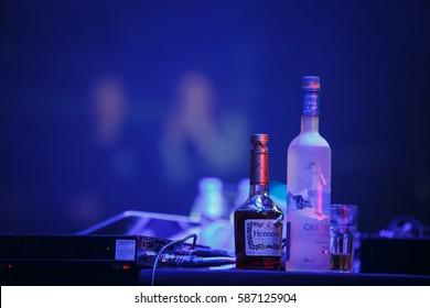 MOSCOW-6 FEBRUARY,2017:Grey Goose&Hennesey.Vodka bottle,Hennesy cognac bottles on stage for famous musician,celebrity singer.Strong alcoholic drinks for celebrities rider on scene.Hennsessy VS Cognac