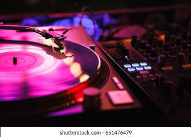 MOSCOW-6 JUNE,2016:Dj turntable on hip hop music party in nightclub.Professional disc jockey audio equipment.Turntables vinyl records player on concert stage.Needle on disc with musical tracks