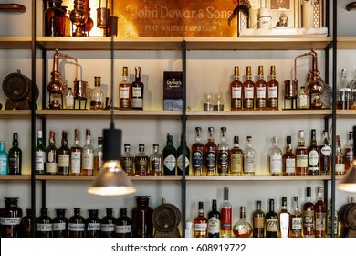 MOSCOW-6 MARCH,2017:Alcohol bar interior.Strong liquor bottles on shelves.Illuminated popular pub interior,focus on whiskey bottle shelf with expensive drinks