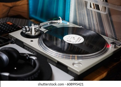 MOSCOW-6 MARCH,2017:Dj turn tables.Professional disc jockey,audiophile hifi turntable records player to play music.Hipster audio equipment.Disc jockey turntable on stage in the club