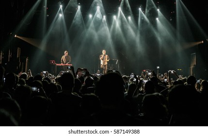 MOSCOW-6 OCTOBER,2016:Rock concert crowd in music hall.Famous band Vacuum perform on stage in night club.Bright stage lights on pop festival.Singer on scene,big crowd party on the dancefloor