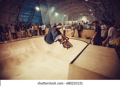 MOSCOW-6 SEPTEMBER,2015:Teenager skater boy jumps on mini ramp in skatepark.Popular youth extreme sports competition background