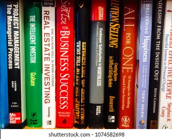 Moscow-7 march 2018: Motivational books on bookshelf on background. Colorful books for success. Education concept background. Stack of colorful books. Book Stack of business books in the library